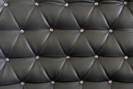 upholstered: Black upholstery pattern with diamonds