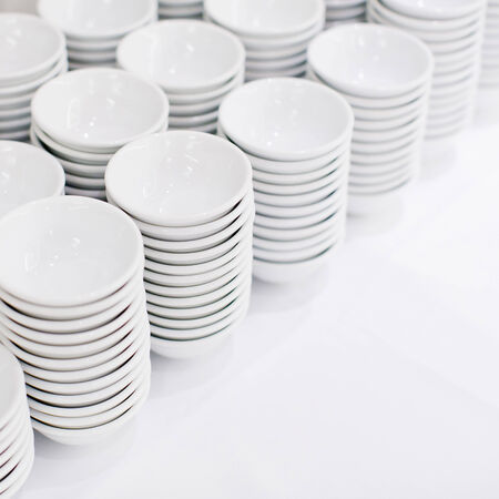 a stack of white dishes en soup bowls photo