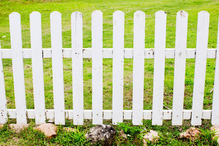 White fence with green grass photo