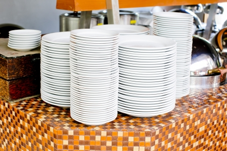 clean dishes: Stacked white dishes Stock Photo