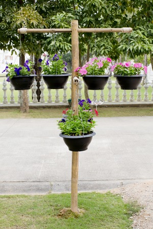 Wood stand with pots of flowers photo