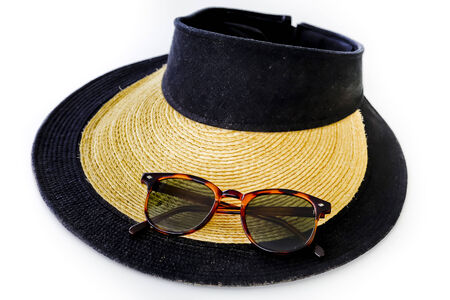 sunprotection objects sunglasses and hat photo