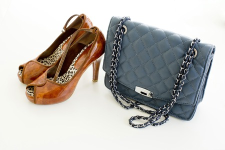 Ladies Leather blue handbag and brown color of high heel shoes isolated on white background photo