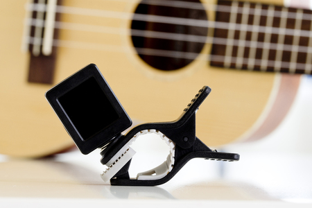 guitar tuner: Clip tuner Equipment For tuning the ukulele guitar sound  Stock Photo