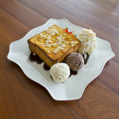 Ice cream with bread on plate photo