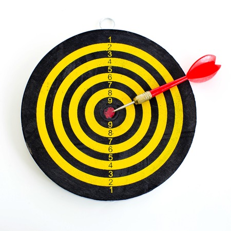 One darts in center of target isolated on white photo