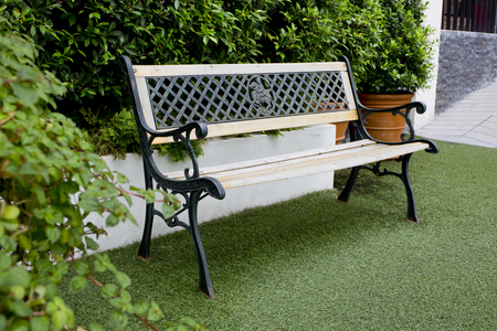 White classic bench in the garden photo
