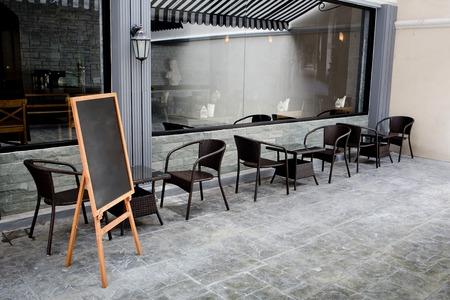 Concept and design front of Coffee Shop with black board and black seating Foto de archivo