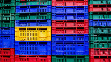 many colors stack of plastic crates background photo