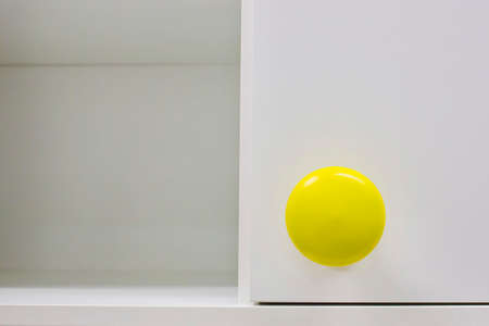 cabinets: Cupboard handle with yellow color