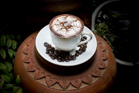 capacino: Art latte on hot coffee with coffee beans. Stock Photo