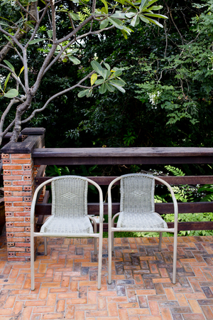 Out door couple of rattan chairs. photo