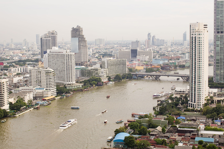 river scape: top view ship on Chao Phraya river, bridge and city scape in Bangkok, Thailand Stock Photo