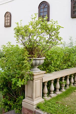 banister: ceramic flowerpots on banister