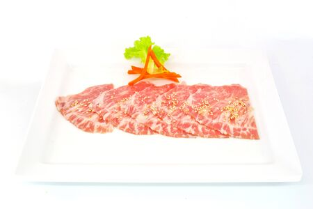 sizzle: High grade sliced Hida wagyu beef isolated on white