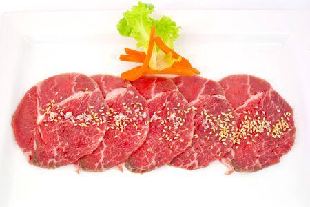 sizzle: High grade sliced Hida wagyu beef isolated on white background Stock Photo