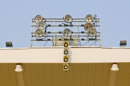 public address: White loudspeakers and spotlight on the metal construction Stock Photo
