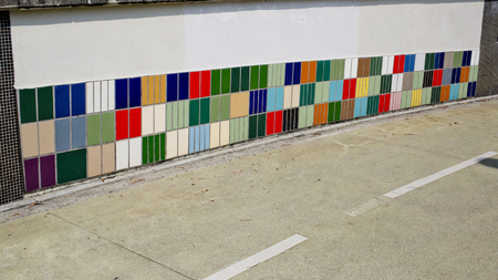 sidewall: colorful tile of sidewall along a road