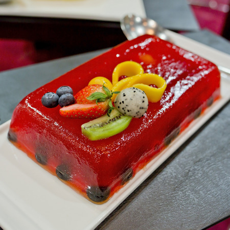 strawberry jelly: Strawberry Jelly Cake with many fruits topping Stock Photo