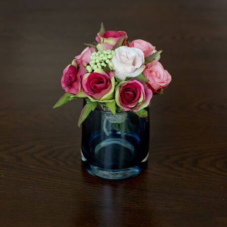 Glass vase with flowers, a beautiful ornament in a wedding photo
