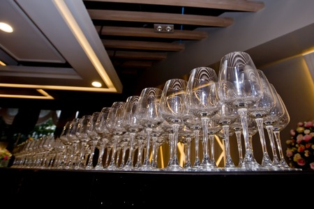 in a row: Row of wine glasses