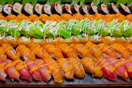 buffet: Japanese Cuisine -Buffet catering style Sushi Set in restaurant - salmon Maki Sushi and Nigiri Sushi