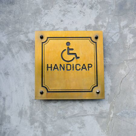 handicap sign: Disabled Handicap Icon and wording Handicap Sign made from gold metal board