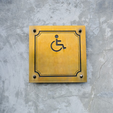 handicap sign: Disabled Handicap Icon Sign made from gold metal board