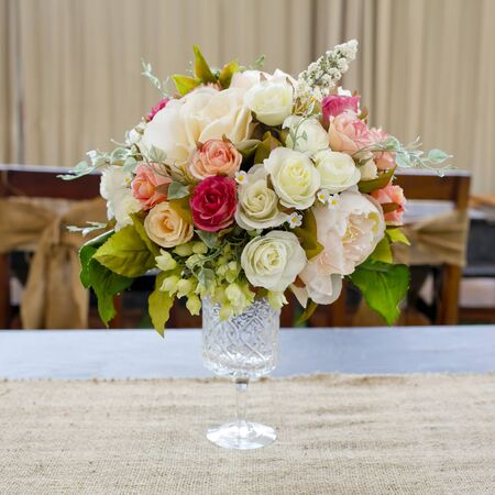Blossom rose placed on the desk in dine room photo