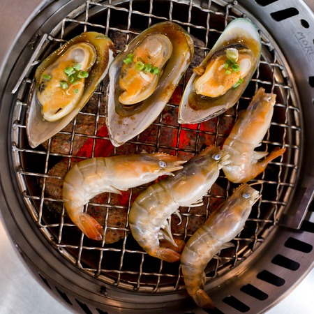 roster: grilled seafood, prawns and squids Stock Photo