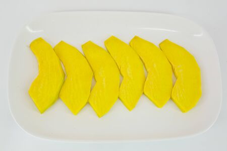 marrow squash: sliced pumpkin ready to be grilled isolate on white background