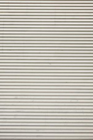 shutter door: Steel shiny rolling shutter door texture with horizontal lines.