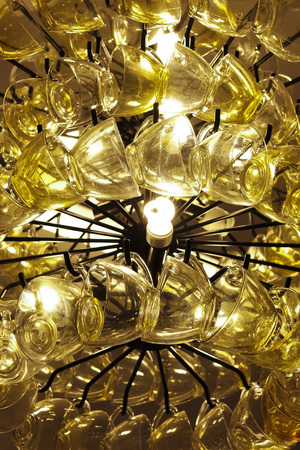 electric fixture: Close up Contemporary chandelier made of many yellow coffee cups.