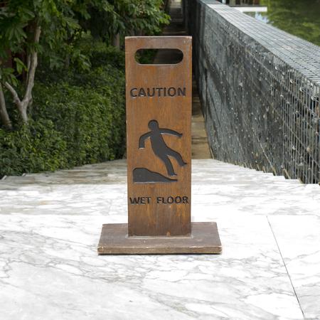 cantonese: Caution wet floor wooden sign board Stock Photo