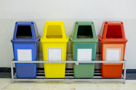 Different Colored wheelie bins set with waste icon Banque d'images