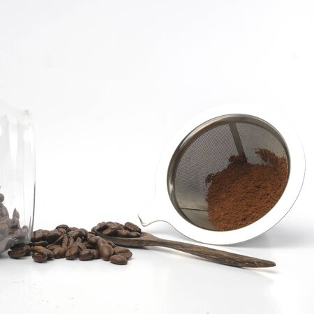 Coffee Beans And Ground Coffee on white background
