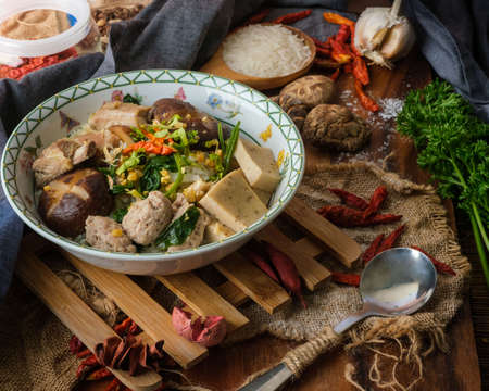 Boiled rice with pork, bone and thai pork sausage in bowl. Thailand is a popular breakfast.