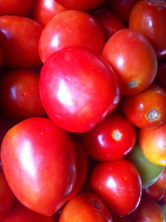 Closeup red tomato background