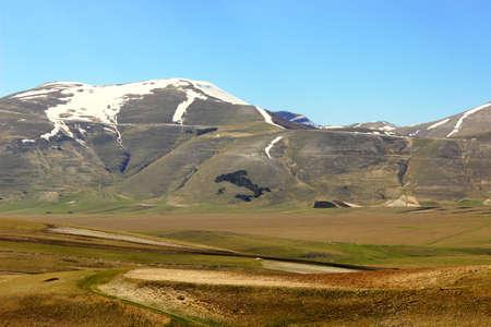 Italian mountain landscape with Italy symbol