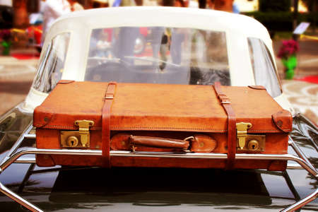 Vintage car with leather suitcase