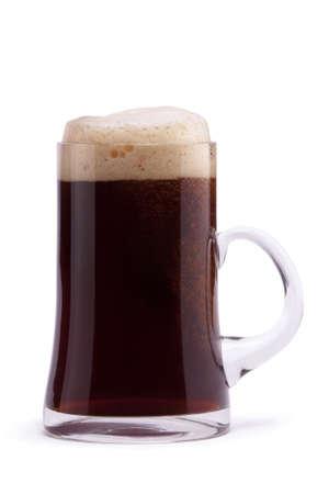 Dark beer in mug on white background Stock Photo