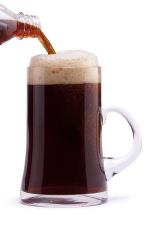 Dark beer in mug on white background photo