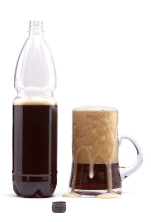 Beer is poured into a mug from a flask