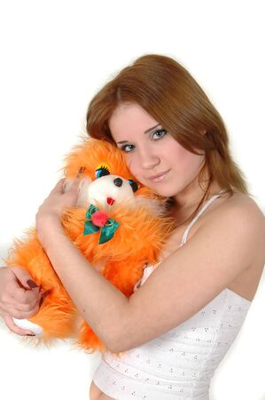 pretty young girl hugging an orange toy