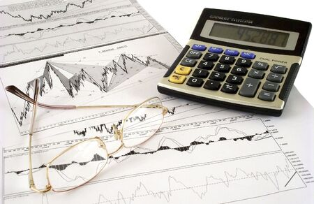 Composition of calculator, chart and spectacles photo
