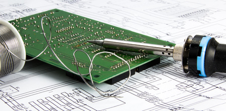solder: Board with soldering iron and solder