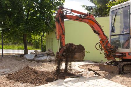 Earthwork with an excavator Stockfoto