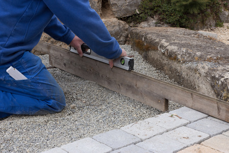 Straighten a paved surface