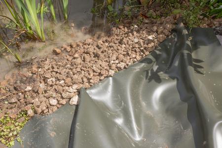 Create a creek toward the pond Foto de archivo
