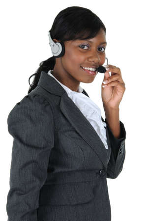 A attractive business woman wearing a headset, isolated on a solid white background.